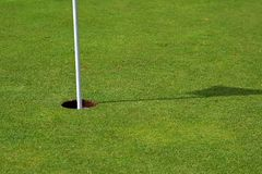 Golf Hole (left side). Golf hold on a perfect green (left side Royalty Free Stock Photo