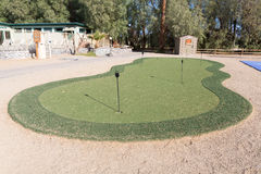 Golf hole in putting green. putting green is a mini golf course. Golf hole in putting green. The putting green is a mini golf course to practice the putter golf Stock Images