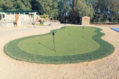 Golf hole in putting green. putting green is a mini golf course. Golf hole in putting green. The putting green is a mini golf course to practice the putter golf Stock Image