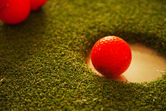 Golf im Loch Stockfotografie
