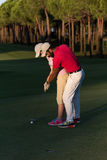Golf instructions. Male golf instructor teaching female golf player, personal trainer giving lesson on golf course Royalty Free Stock Image