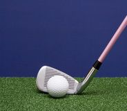 Golf Iron And Ball Stock Photo