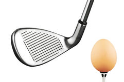 golf iron club and egg Stock Photos