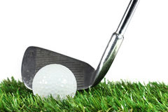 Golf iron and golf ball. On green grass Royalty Free Stock Photography