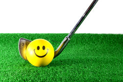 Golf iron ready to hit. Yellow ball with smile Royalty Free Stock Image