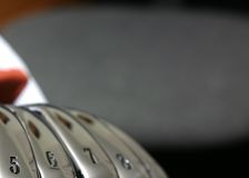 Golf Irons. In a row royalty free stock images