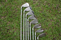 Golf irons on the fairway grass Royalty Free Stock Image