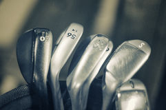 Golf irons macro detail. Macro detail of golf irons, sand and loft wedges or irons - sepia toned stock image
