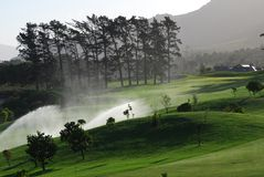 Golf irrigation. Water irrigation on Western Cape Golf Course, South Africa Stock Photos