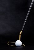 Golf items on dark background Stock Photography