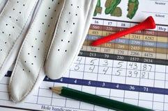 Golf-Kerbe-Karte mit Handschuh, Bleistift u. T-Stück Stockbilder