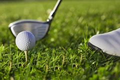 Golf kicker play. Golf bat with kicker bat and golf shoos close up Stock Image