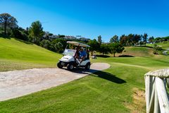 Golf at La Cala de Mijas, Spain on a sunny day with green grass and beautiful landscape.