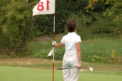 Golf lady with flag Stock Image