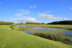 Golf and Lake Stock Photos