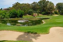 Golf lake next to bunker Stock Photo