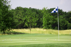 Golf landscape. Pictire of golf landscape with green grass and flag Stock Photos