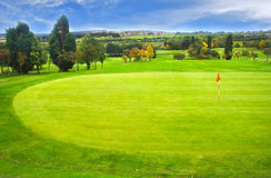 Golf Landscape. Beautiful green golf field and trees Stock Image