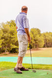 Golf learner. Learning sports in higher age Stock Photography