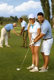 Golf lesson. Happy female golfer learning to play stock photo