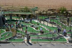 Golf loco en la playa de Brighton Imagen de archivo libre de regalías
