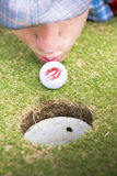 Golf Love At First Flight. Man In Love With Golf Kisses Ball On Golfing Green Wishing It Luck Before Putting Into The Hole In Golf Love At First Flight Concept Stock Photo
