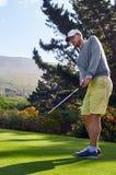 Golf man on fairway. Golfer making birdie on beautiful scenic course Royalty Free Stock Photos