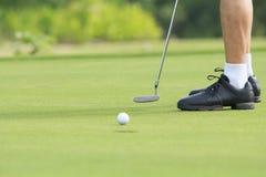 Golf man putting on green Stock Photos