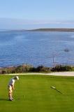 Golf man putting on green Stock Photo