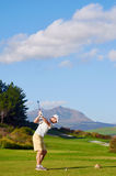 Golf man teeing off Stock Photography