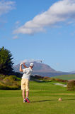 Golf man teeing off Stock Images