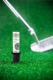 Golf med pengar Fotografering för Bildbyråer