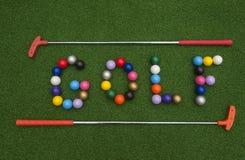 GOLF in Mini Golf Balls stock foto's