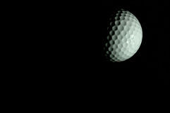 Golf moon. Golf ball is lighted in the dark to imitate the half moon Royalty Free Stock Photography