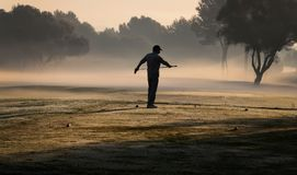 Golf and morning fog golden stock image