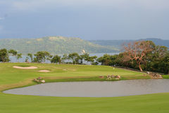 Golf and ocean. Golf course with pond and ocean Royalty Free Stock Images