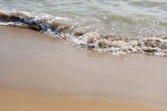 Golf op het zandstrand stock foto's
