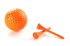 Golf In Orange. An orange golf ball and two orange tees Stock Photography