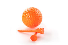 Golf In Orange. An orange golf ball and two orange tees Royalty Free Stock Photography