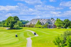 Golf place and custom built luxury big house on Stock Images