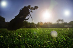Golf play. Golf ball with golf bag in background royalty free stock images