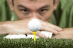 Golf player. Looking at the ball on the tee Stock Images