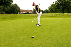 Golf player. The picture shows a Golf player while putting the ball in the hole Stock Photography