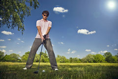 Golf Player. Male golf player teeing off golf ball from tee box Stock Images