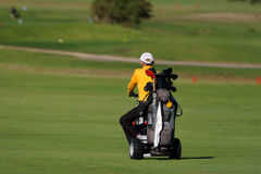 Golf player. Drives on the grass field Royalty Free Stock Photography