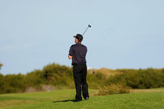Golf player. On the grass field Stock Photography