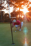 Golf player aiming perfect  shot on beautiful sunset Royalty Free Stock Photo
