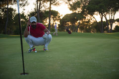 Golf player aiming perfect  shot on beautiful sunset Stock Photo