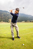Golf player Charging the shot Stock Image