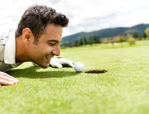 Golf player cheating Royalty Free Stock Image